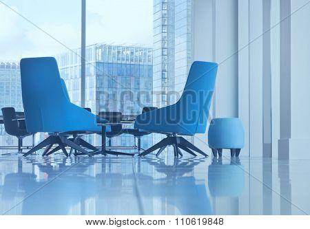 Small seat and modern blue office arm chairs in open space boardroom