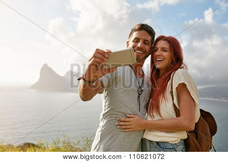 Smiling Young Loving Couple Taking Selfie