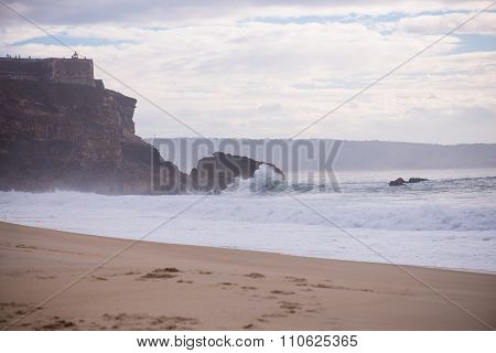 Wave Crashing On A Coast In Nazare, Portugal.