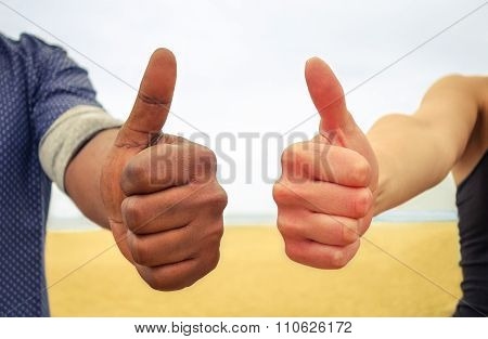 Multiracial Thumbs up concept against racism and to ensure human rights