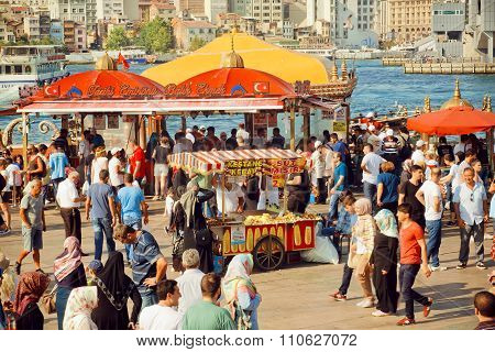 Crowd Of Walking People On Popular Bosphorus Promenade With Sellers Of Fast Food
