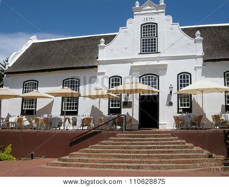 White house in colonial style on wine farm Stellenbosch, South Africa