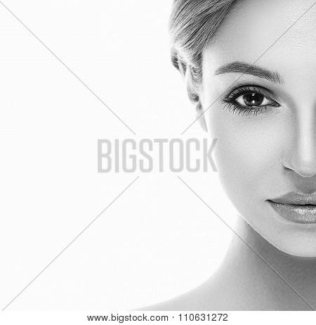 Beautiful woman half face close up studio on white