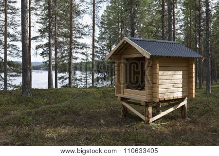 Outdoor rustic cabin, shelter for backpackers by a river.