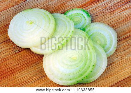 onion rings on wooden board