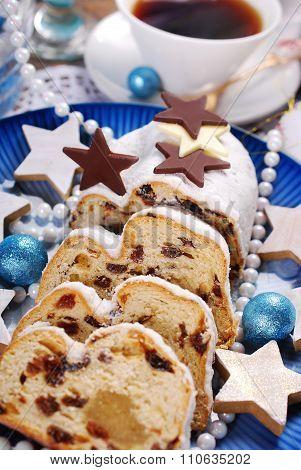 Sliced Christmas Stollen Cake On Blue Plate