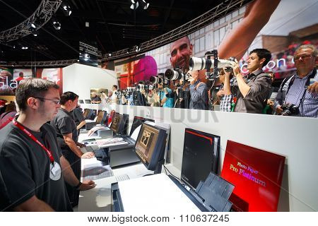 COLOGNE, GERMANY - SEPTEMBER 19, 2014: Canon stand at the Photokina Exhibition. The Photokina is the world's largest trade fair for the photographic and imaging industries