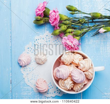 Meringues And Pink Flowers On The Table, Top View