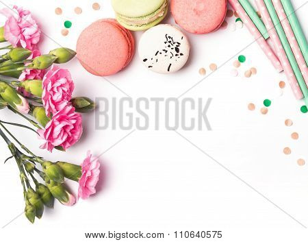 Flowers, Macarons And Paper Straws On The White Background