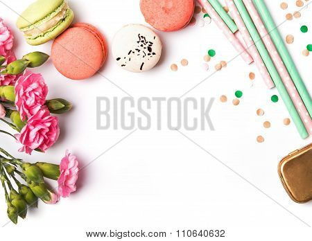 Macarons, Paper Straws, Flowers And Confetti On The White Background