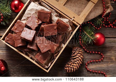 Christmas fudge traditional homemade chocolate sweet dessert food in wooden box on vintage table bac