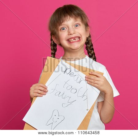 lost tooth girl portrait, studio shoot on pink background