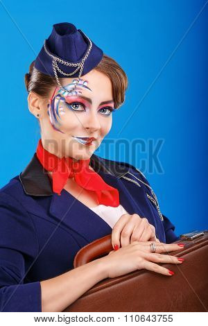 Stewardess With Face Art Baggage Holds.