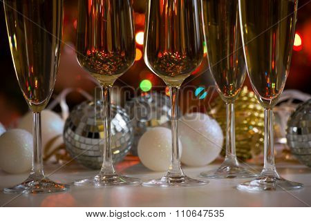 Glasses of champagne and christmas balls on the background
