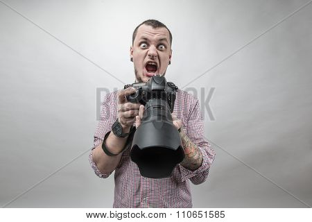 Man with photo camera shocked