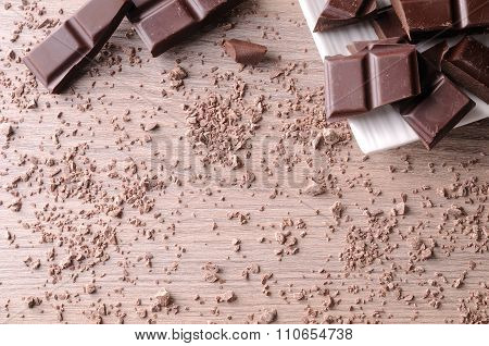 Portions And Sparse Chocolate Chips On Wood Table Top View