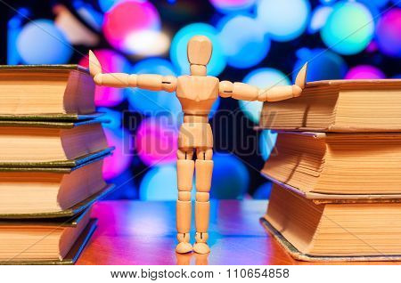Education, knowledge and people concept - wooden student keep books
