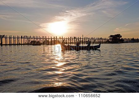 U Bein Bridge at sunset in Mandalay Myanmar. The 1.2-kilometre bridge was built around 1850 and is believed to be the oldest and longest teakwood bridge in the world