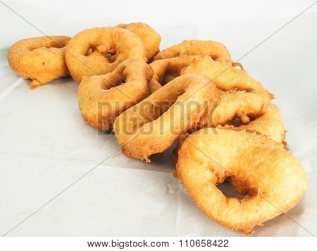 Freshly Made Doughnuts In A Small Pile On Baking Paper