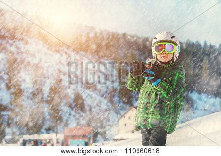 Young Skier In Full Ski Equipment In Ski Areal
