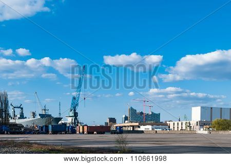 HAMBURG, GERMANY - May 1, 2013: Panorama view at the industrial port area.  Harbor cargo freight terminal German sea harbor on the river Elbe famous Elbphilharmonic hall under construction