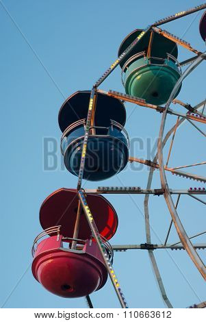 amusement park carousel big wheel on blue sky