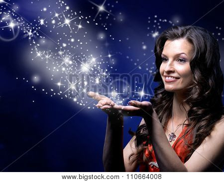 young woman catches Star rain by hands