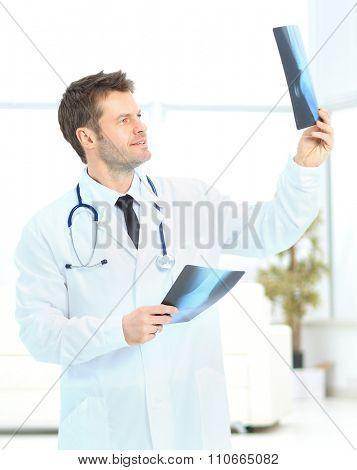 young doctor consider x-ray photos enthusiastically