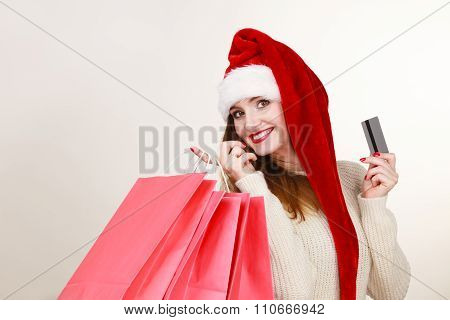 Woman Santa Claus Hat Holds Shopping Bags