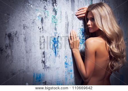 Portrait of a beautiful young woman with bare shoulders