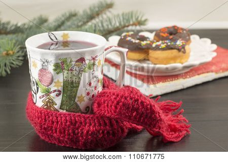 Tee In A Decoupage Decorated Christmas Teacup And Donuts
