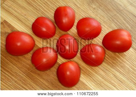 cherry tomatoes on wooden background table