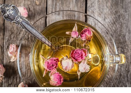 Closeup of green tea cup with dried roses