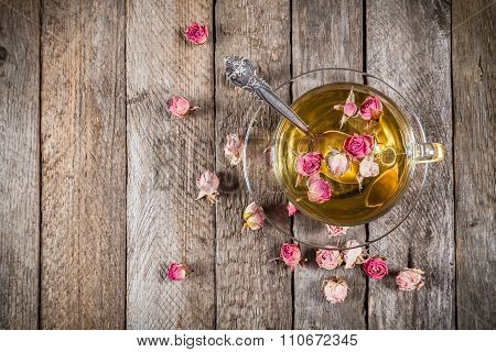 Top view of green tea cup with dried roses