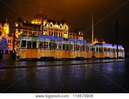Unidentified People Traveling On The Special Christmas Tram With Festive Lights In Budapest Hungary