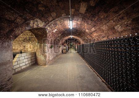 Long underground brick tunnel in the wine cellar