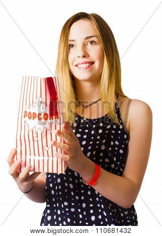Person At Movie Cinema With Popcorn Bag