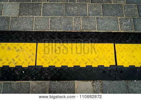 Rubber Speed Bump On A Road