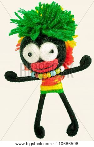 Toy Afro American Boy In A Traditional Costume With Bead And Green Hairs Made From Thread Isolated O