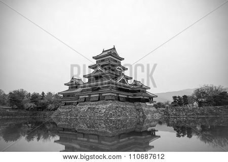 Masumoto Castle , Black  In  Japan With Clear Sky With Mirror Pond Black And White