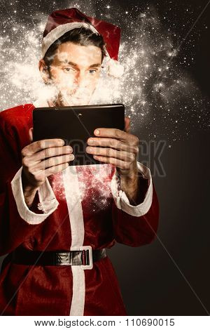 Tech Santa Browsing Online With Magical Tablet