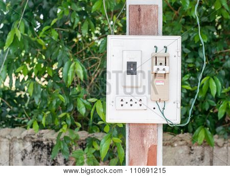 The Modern Breaker Switch And The Old Breaker Switch With White Plug Are Hang Wood Pillar On Nature