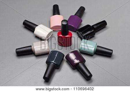 Coloured Nail Polish Bottles Stacked Circle