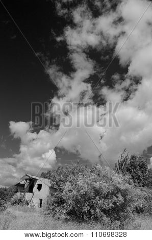 Rural Landscape With Clouds And Desolate House
