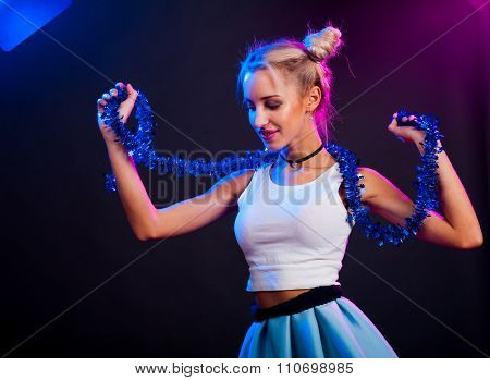 Young nice girl have fun on a dance party