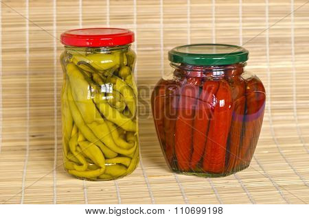 Two Jars With Marinated Peppers Vegetables