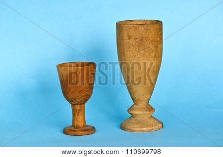 Two Wooden Antique  Glasses Cup On Blue Background