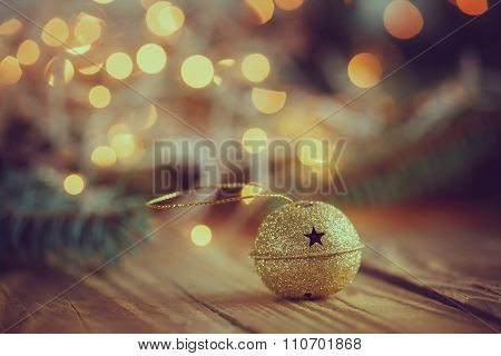Metal Jingle Bell With Star On Wooden Table. Christmas Backgroun