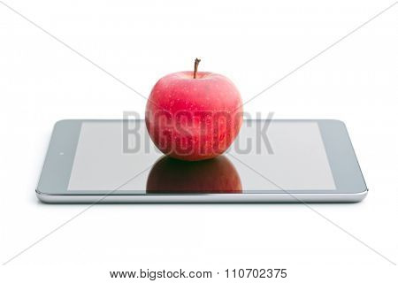 red apple and computer tablet on white background