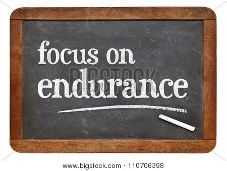 Focus on endurance advice  - white chalk text on a vintage slate blackboard